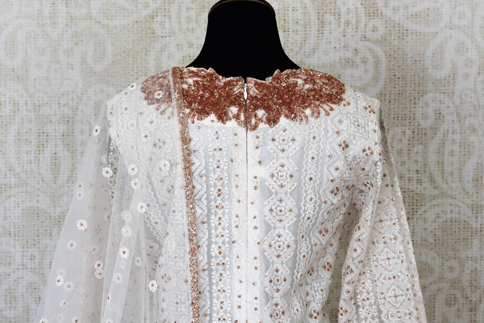 White embroidered net suit with palazzo for online shopping in USA. Get floored by a vibrant collection of Indian clothing at Pure Elegance Indian fashion store in USA. Choose from a beautiful range of Indian designer suits, Anarkalis, designer lehengas for weddings and special occasions.-back