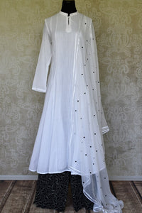 Buy white cotton suit online in USA with black printed palazzo and dupatta. Make special occasions even more special with your captivating traditional style in designer salwar suits from Pure Elegance Indian clothing in USA.-full view