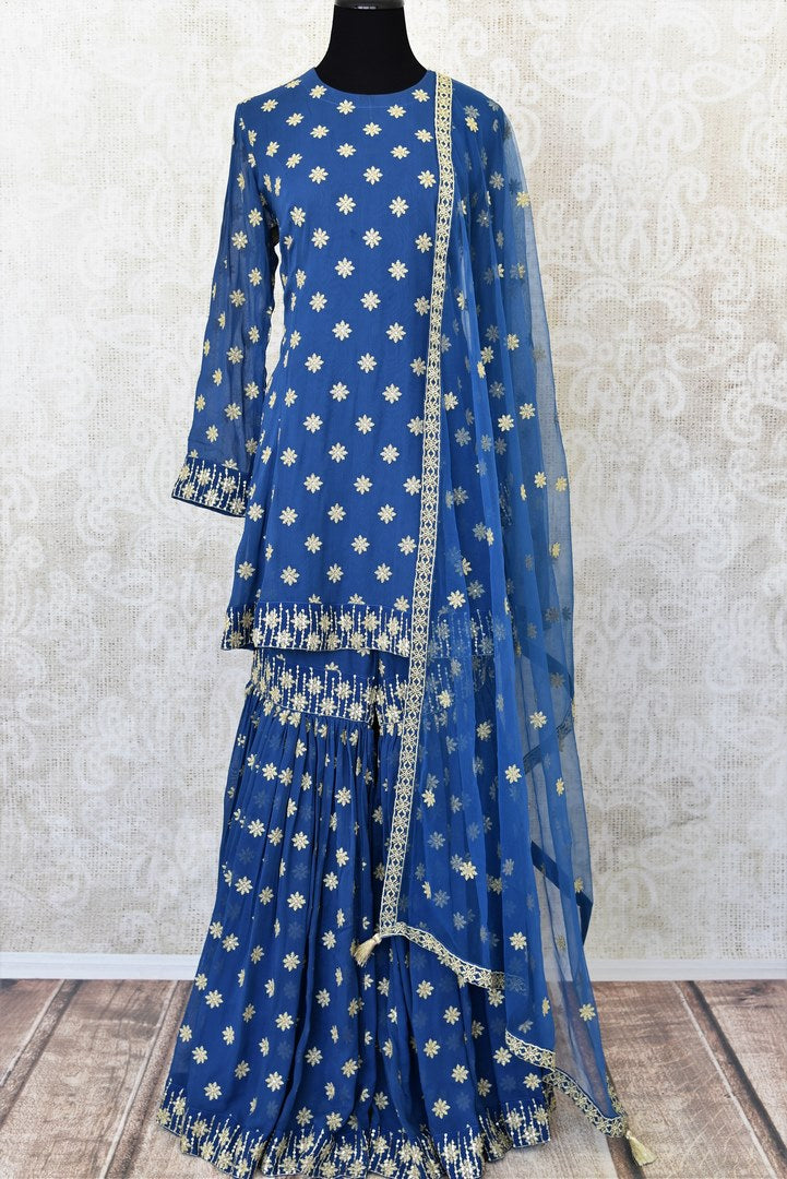 Blue embroidered georgette suit with sharara for online shopping in USA. Get floored by a vibrant collection of Indian clothing at Pure Elegance Indian fashion store in USA. Choose from a beautiful range of Indian Salwar suits, Anarkalis, designer lehengas for weddings and special occasions.-full view