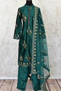 Elegant dark green embroidered velvet salwar suit with dupatta for online shopping in USA. Get floored by a vibrant collection of Indian clothing at Pure Elegance Indian fashion store in USA. Choose from a beautiful range of Indian Salwar suits, Anarkalis, designer lehengas for weddings and special occasions.-full view