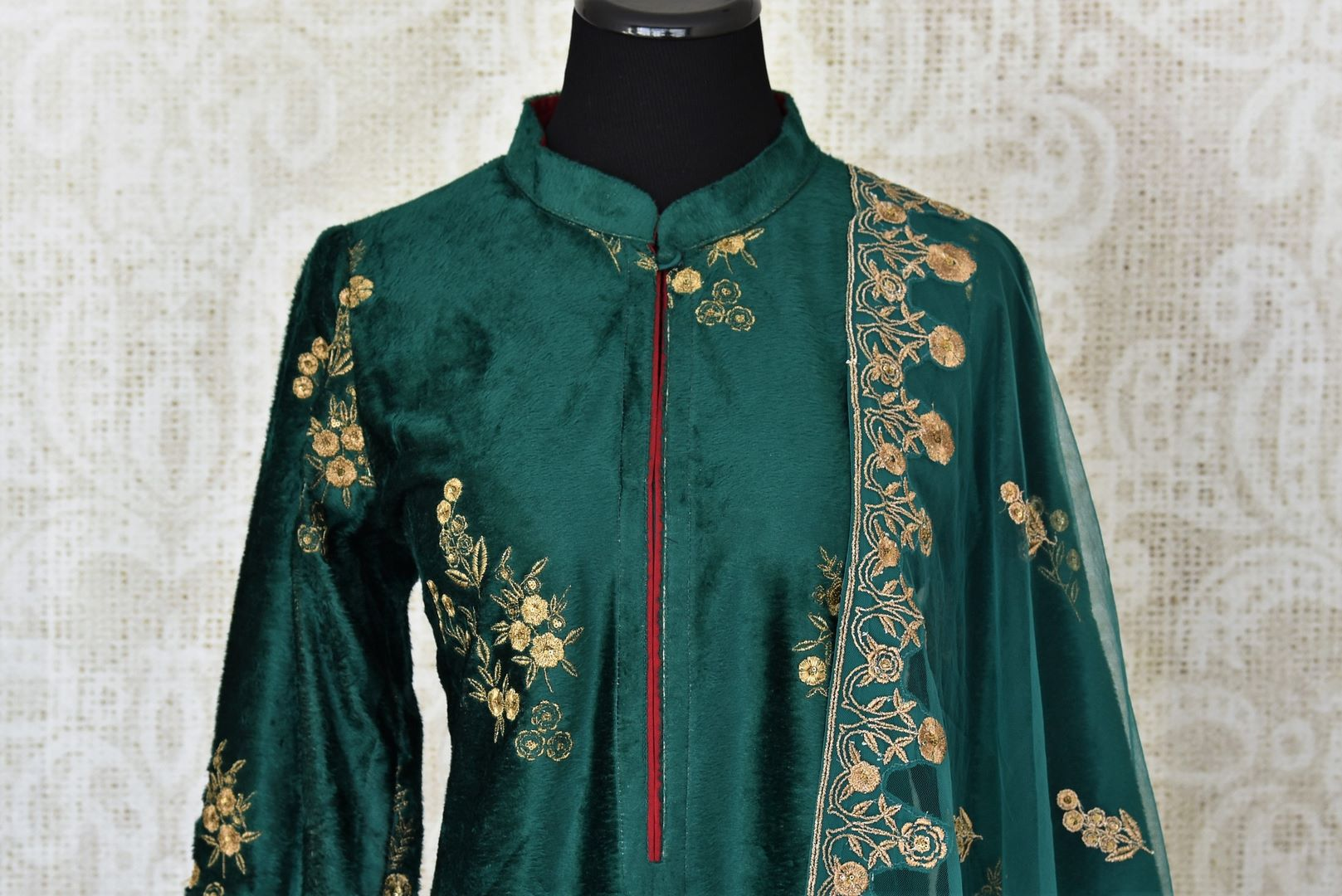Elegant dark green embroidered velvet salwar suit with dupatta for online shopping in USA. Get floored by a vibrant collection of Indian clothing at Pure Elegance Indian fashion store in USA. Choose from a beautiful range of Indian Salwar suits, Anarkalis, designer lehengas for weddings and special occasions.-front