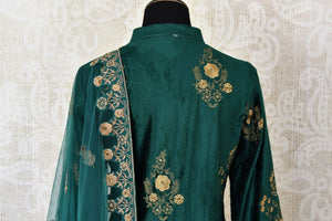 Elegant dark green embroidered velvet salwar suit with dupatta for online shopping in USA. Get floored by a vibrant collection of Indian clothing at Pure Elegance Indian fashion store in USA. Choose from a beautiful range of Indian Salwar suits, Anarkalis, designer lehengas for weddings and special occasions.-back