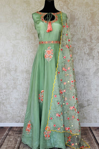 Shop green embroidered sleeveless silk Anarkali online in USA with dupatta. Pick your favorite Indian clothing from a colorful collection available at Pure Elegance Indian fashion store in USA. We have an alluring range of wedding lehengas, designer Anarkali suits, gowns for Indian women in USA.-full view