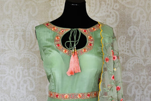Shop green embroidered sleeveless silk Anarkali online in USA with dupatta. Pick your favorite Indian clothing from a colorful collection available at Pure Elegance Indian fashion store in USA. We have an alluring range of wedding lehengas, designer Anarkali suits, gowns for Indian women in USA.-front