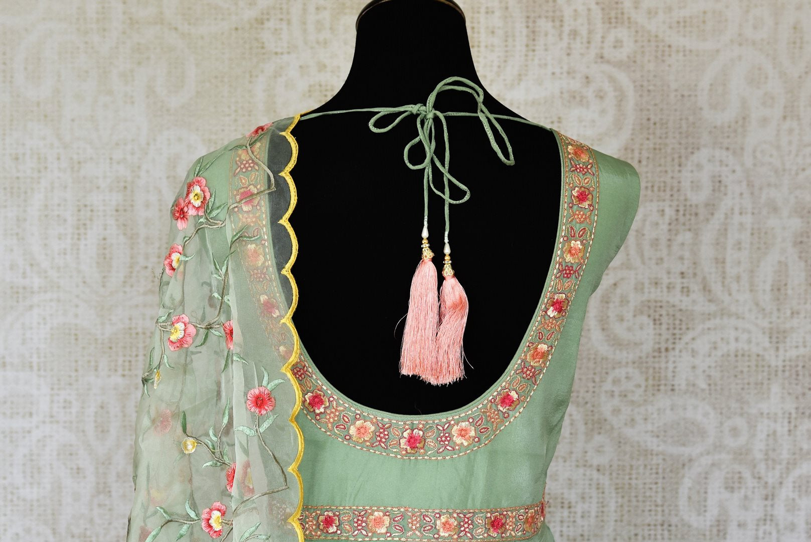 Shop green embroidered sleeveless silk Anarkali online in USA with dupatta. Pick your favorite Indian clothing from a colorful collection available at Pure Elegance Indian fashion store in USA. We have an alluring range of wedding lehengas, designer Anarkali suits, gowns for Indian women in USA.-back