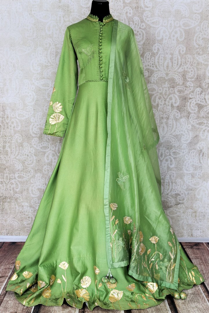 Green embroidered floorlength silk Anarkali for online shopping in USA with dupatta. Get floored by a vibrant collection of Indian designer clothes at Pure Elegance Indian fashion store in USA. Choose from a beautiful range of Indian wedding dresses, designer lehengas and suits for special occasions.-full view