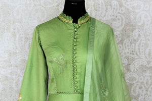 Green embroidered floorlength silk Anarkali for online shopping in USA with dupatta. Get floored by a vibrant collection of Indian designer clothes at Pure Elegance Indian fashion store in USA. Choose from a beautiful range of Indian wedding dresses, designer lehengas and suits for special occasions.-front