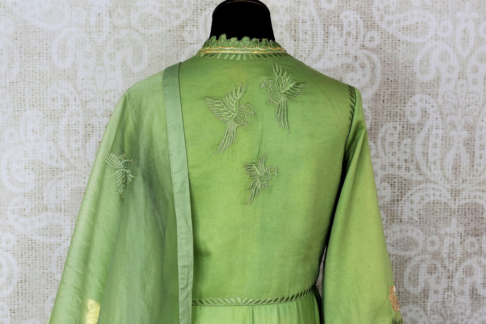 Green embroidered floorlength silk Anarkali for online shopping in USA with dupatta. Get floored by a vibrant collection of Indian designer clothes at Pure Elegance Indian fashion store in USA. Choose from a beautiful range of Indian wedding dresses, designer lehengas and suits for special occasions.-back