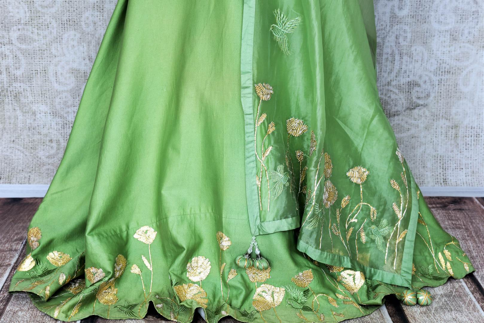 Green embroidered floorlength silk Anarkali for online shopping in USA with dupatta. Get floored by a vibrant collection of Indian designer clothes at Pure Elegance Indian fashion store in USA. Choose from a beautiful range of Indian wedding dresses, designer lehengas and suits for special occasions.-bottom