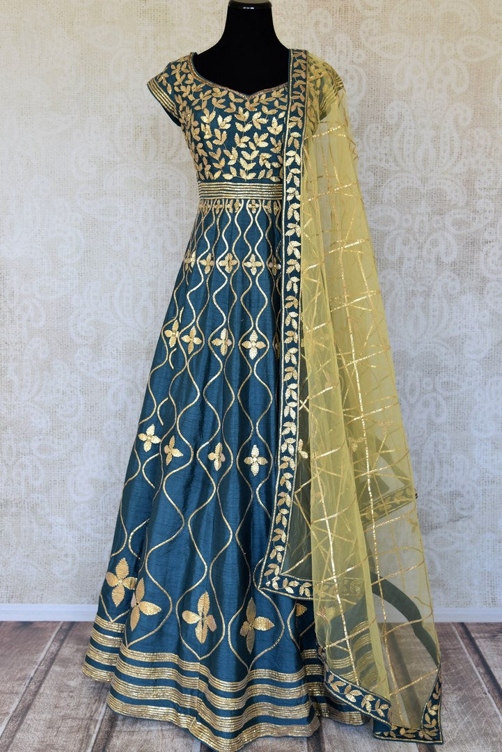 Buy teal blue lace applique silk Anarkali suit online in USA with yellow dupatta. Keep your wardrobe update with latest Indian clothing from Pure Elegance Indian fashion store in USA. Shop beautiful Indian designer lehengas, Anarkali suits, gowns for Indian women in USA from our online store.-full view