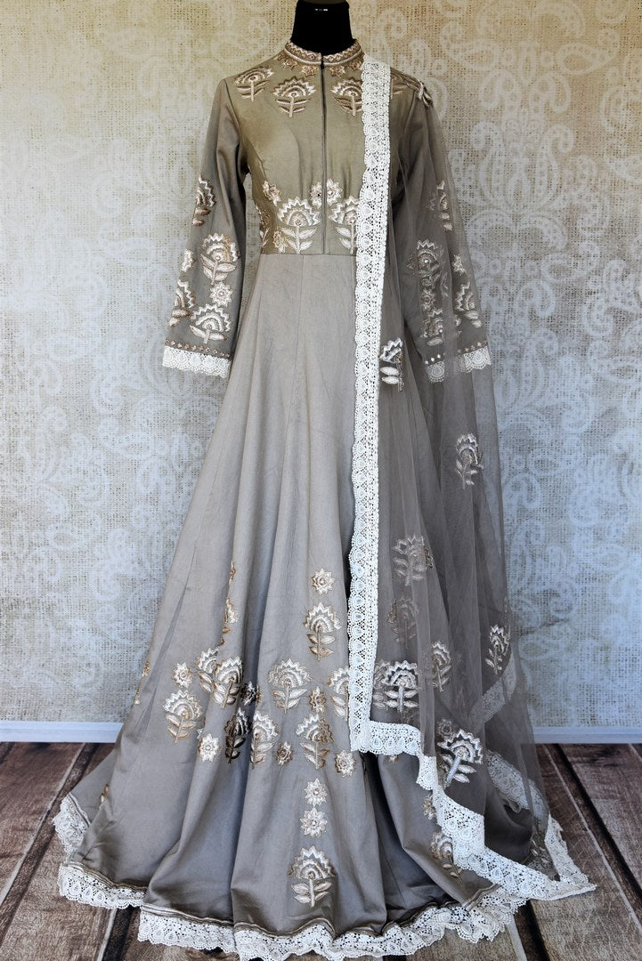 Buy grey silk embroidered floorlength Anarkali suit online in USA with dupatta. Keep your wardrobe update with latest Indian clothing from Pure Elegance Indian fashion store in USA. Shop beautiful Indian designer lehengas, Anarkali suits, gowns for Indian women in USA from our online store.-full view