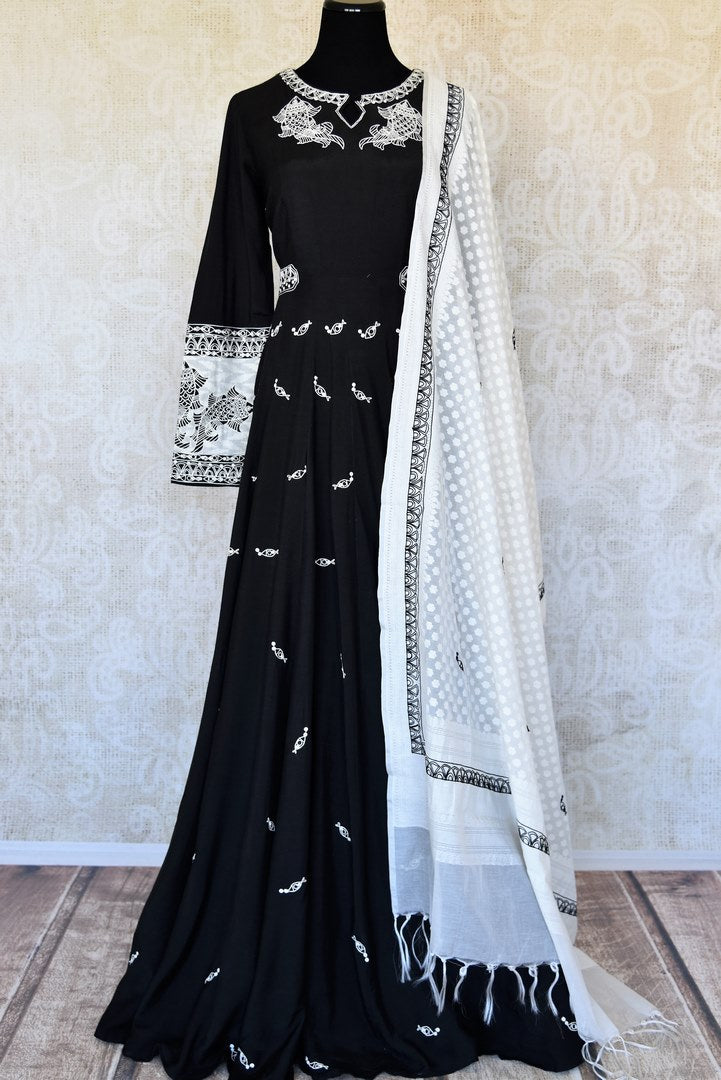 Buy black embroidered cotton silk Anarkali suit online in USA with white dupatta. Keep your wardrobe update with latest Indian clothing from Pure Elegance Indian fashion store in USA. Shop beautiful Indian designer lehengas, Anarkali suits, gowns for Indian women in USA from our online store.-full view