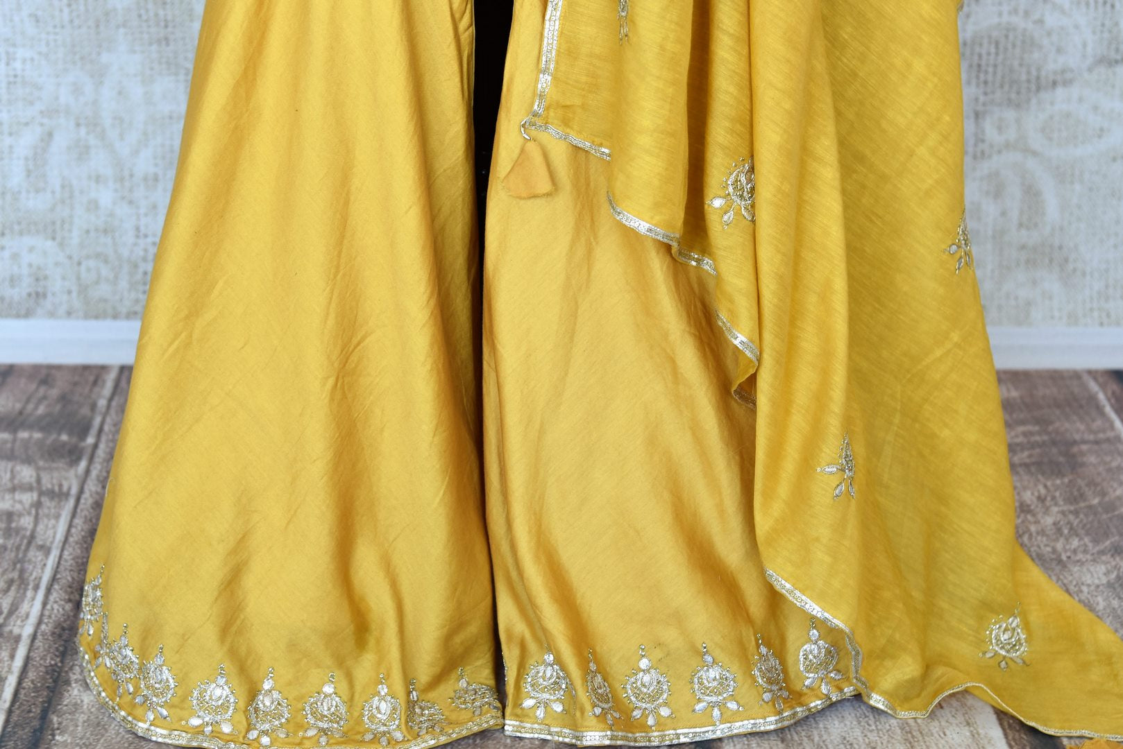 Shop beautiful blue and yellow gota work silk palazzo suit online in USA with dupatta. Keep your wardrobe update with latest Indian clothing from Pure Elegance Indian fashion store in USA. Shop beautiful Indian designer lehengas, Anarkali suits, gowns for Indian women in USA from our online store.-palazzo