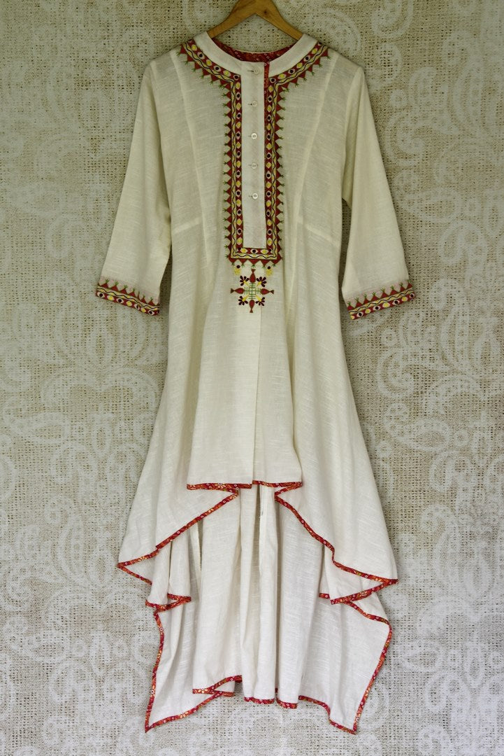 Buy off-white embroidered asymmetric linen dress online in USA from Pure Elegance Indian fashion store in USA. Make a stylish fashion statement this summer with a range of exquisite Indian designer dresses available online and at our clothing store in USA. Shop now.-full view