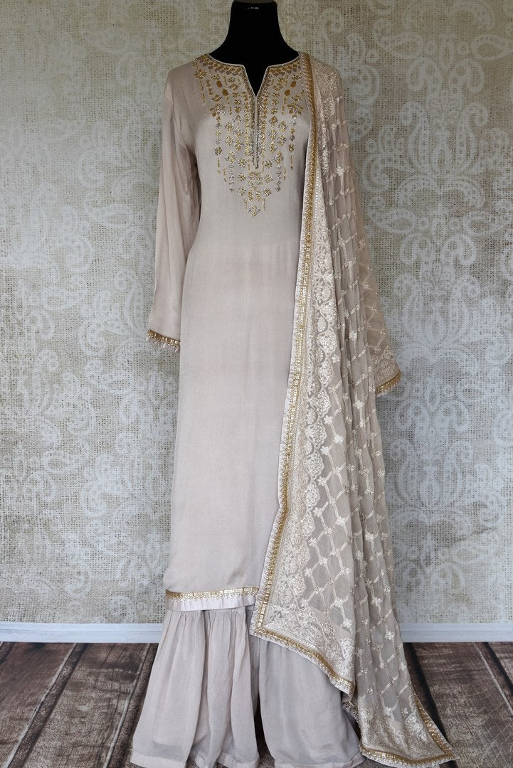 Buy off-white handwork crepe silk palazzo suit online in USA with dupatta. Make fashionable choices with latest Indian designer clothes from Pure Elegance Indian fashion store in USA. Shop traditional Anarkali suits, designer lehengas for Indian brides in USA from our online store.-full view