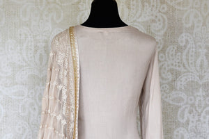 Buy off-white handwork crepe silk palazzo suit online in USA with dupatta. Make fashionable choices with latest Indian designer clothes from Pure Elegance Indian fashion store in USA. Shop traditional Anarkali suits, designer lehengas for Indian brides in USA from our online store.-back