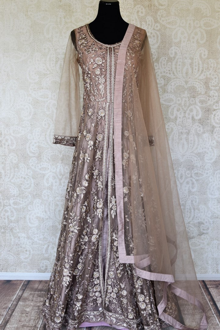 Buy beige embroidered net designer Anarkali suit online in USA with dupatta. Make fashionable choices with latest Indian designer clothing from Pure Elegance Indian fashion store in USA. Shop Indian salwar suits, designer Anarkali suits and bridal lehengas for Indian brides in USA from our online store.-full view