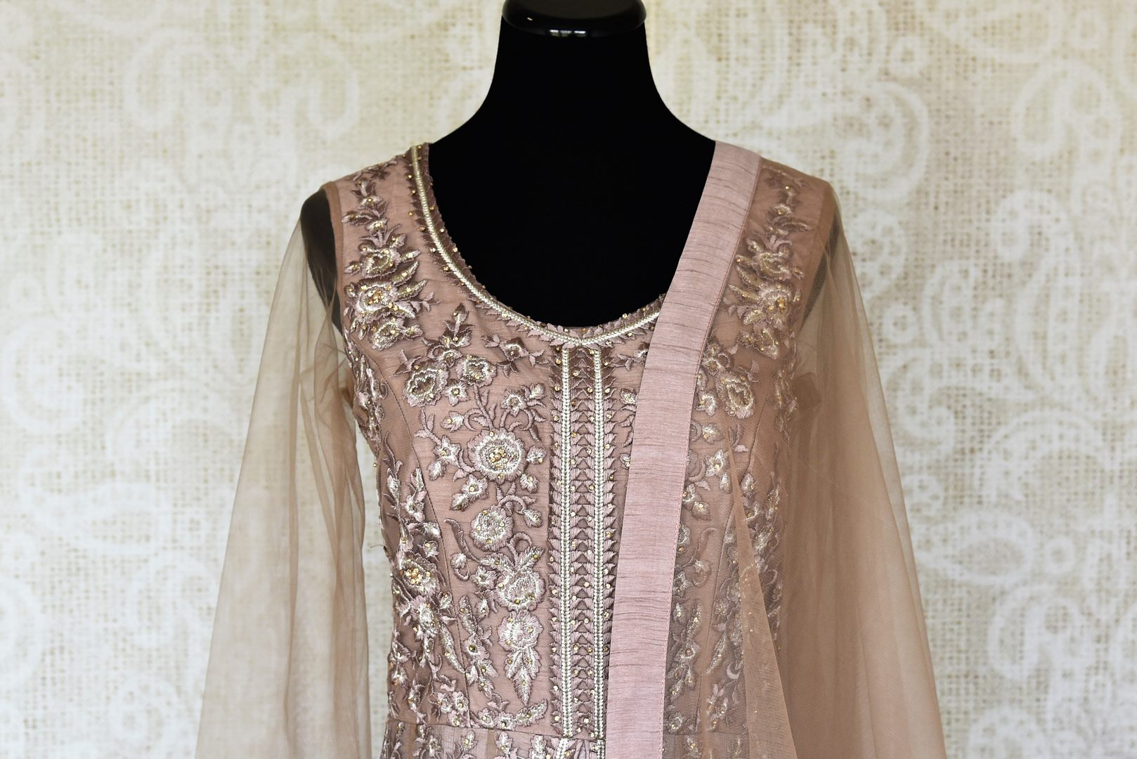 Buy beige embroidered net designer Anarkali suit online in USA with dupatta. Make fashionable choices with latest Indian designer clothing from Pure Elegance Indian fashion store in USA. Shop Indian salwar suits, designer Anarkali suits and bridal lehengas for Indian brides in USA from our online store.-front