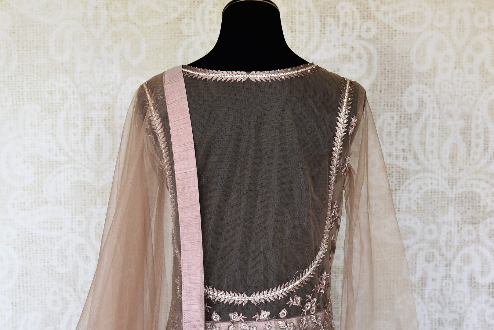 Buy beige embroidered net designer Anarkali suit online in USA with dupatta. Make fashionable choices with latest Indian designer clothing from Pure Elegance Indian fashion store in USA. Shop Indian salwar suits, designer Anarkali suits and bridal lehengas for Indian brides in USA from our online store.-back