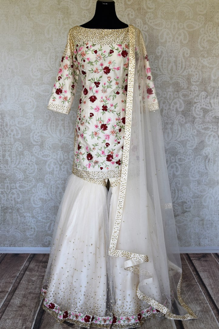 Buy off-white embroidered silk sharara suit online in USA with dupatta. Raise your ethnic style quotient at special occasions with exquisite Indian clothing from Pure Elegance Indian clothing store in USA. Pick from a tasteful collection of designer lehengas, Anarkali suits, Indian dresses. Shop now.-full view