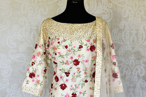 Buy off-white embroidered silk sharara suit online in USA with dupatta. Raise your ethnic style quotient at special occasions with exquisite Indian clothing from Pure Elegance Indian clothing store in USA. Pick from a tasteful collection of designer lehengas, Anarkali suits, Indian dresses. Shop now.-front