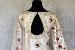 Buy off-white embroidered silk sharara suit online in USA with dupatta. Raise your ethnic style quotient at special occasions with exquisite Indian clothing from Pure Elegance Indian clothing store in USA. Pick from a tasteful collection of designer lehengas, Anarkali suits, Indian dresses. Shop now.-back
