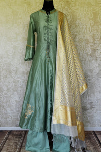 Shop green hand embroidered silk Anarkali suit online in USA with palazzo and cream dupatta. Make special occasions even more special with your captivating traditional style in designer salwar suits from Pure Elegance Indian clothing in USA.-full view