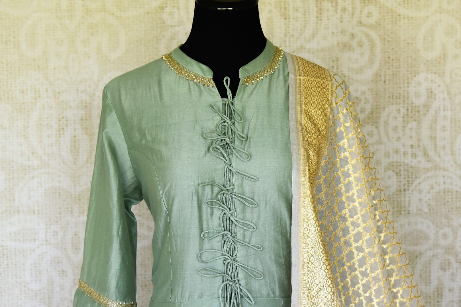 Shop green hand embroidered silk Anarkali suit online in USA with palazzo and cream dupatta. Make special occasions even more special with your captivating traditional style in designer salwar suits from Pure Elegance Indian clothing in USA.-front