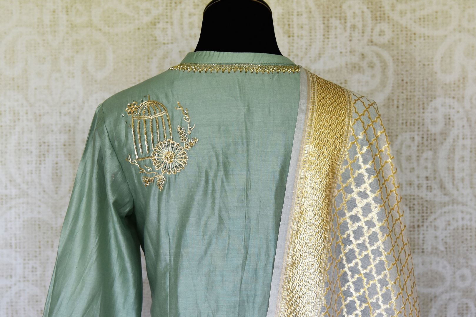 Shop green hand embroidered silk Anarkali suit online in USA with palazzo and cream dupatta. Make special occasions even more special with your captivating traditional style in designer salwar suits from Pure Elegance Indian clothing in USA.-back