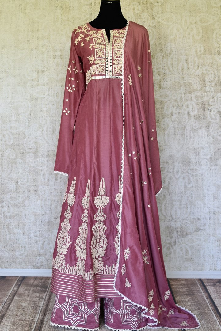 Buy onion pink mirror and hand embroidery silk suit online in USA with palazzo. Make special occasions even more special with your captivating traditional style in designer salwar suits from Pure Elegance Indian clothing in USA.-full view
