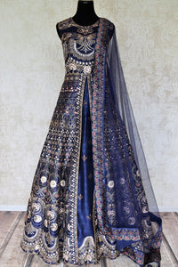 Shop blue silk embroidered Anarkali suit online in USA with net dupatta. Radiate ethnic charm with beautiful Indian designer clothing from Pure Elegance Indian clothing store in USA. Choose from a variety of Anarkali suits, designer Indian suits, designer lehengas for special occasions.-full view