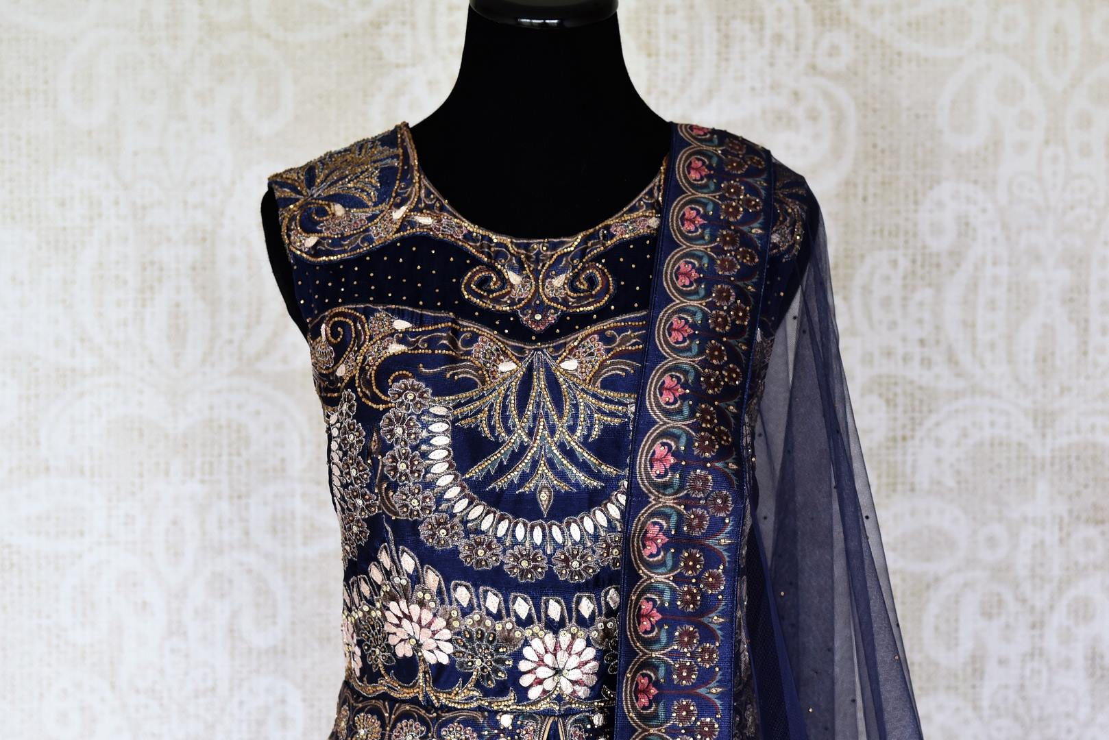 Shop blue silk embroidered Anarkali suit online in USA with net dupatta. Radiate ethnic charm with beautiful Indian designer clothing from Pure Elegance Indian clothing store in USA. Choose from a variety of Anarkali suits, designer Indian suits, designer lehengas for special occasions.-front