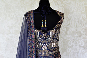 Shop blue silk embroidered Anarkali suit online in USA with net dupatta. Radiate ethnic charm with beautiful Indian designer clothing from Pure Elegance Indian clothing store in USA. Choose from a variety of Anarkali suits, designer Indian suits, designer lehengas for special occasions.-back