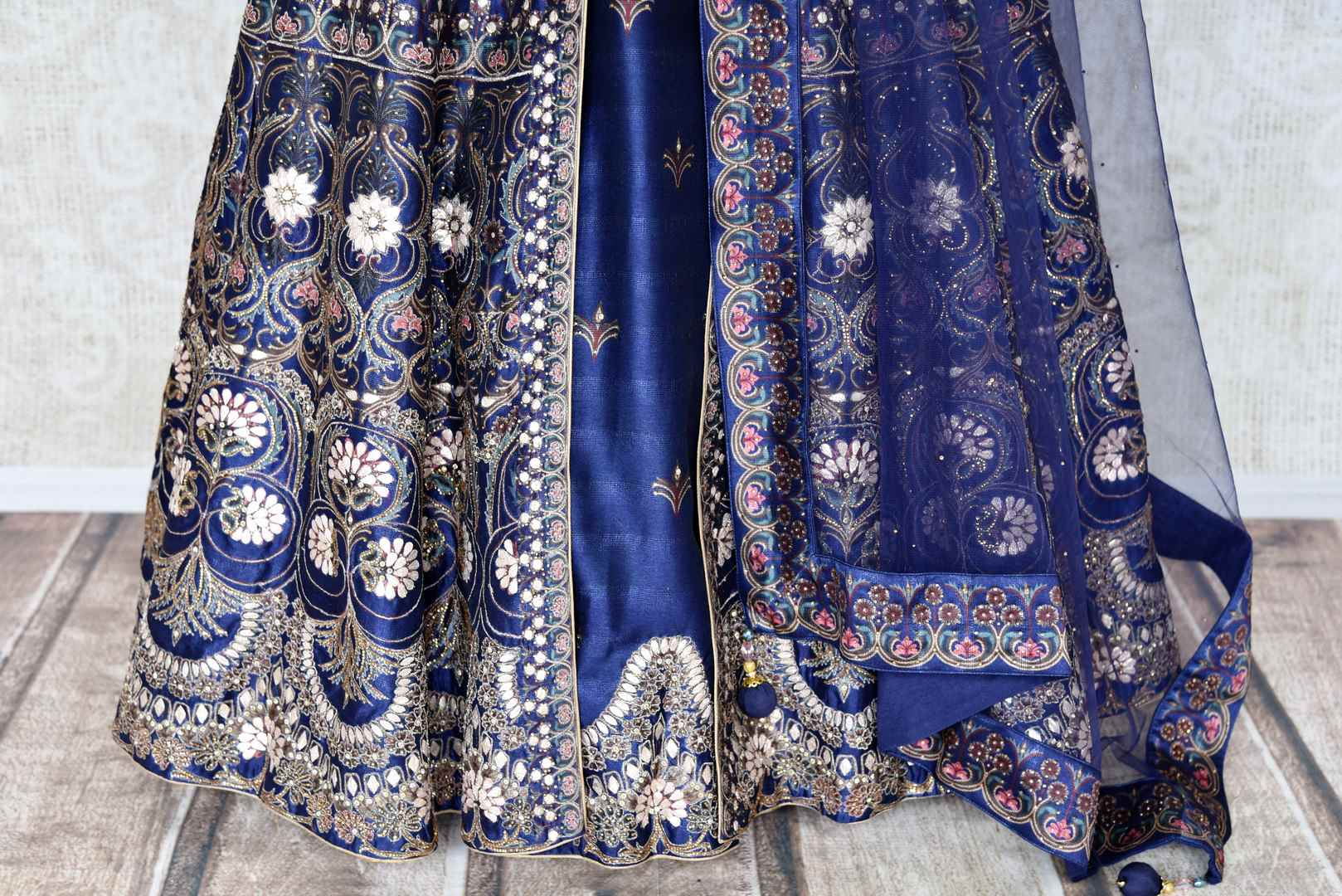 Shop blue silk embroidered Anarkali suit online in USA with net dupatta. Radiate ethnic charm with beautiful Indian designer clothing from Pure Elegance Indian clothing store in USA. Choose from a variety of Anarkali suits, designer Indian suits, designer lehengas for special occasions.-details