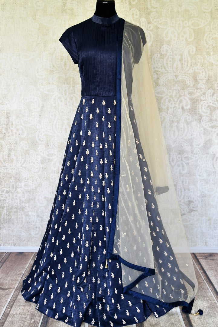 Buy blue silk floorlength designer embroidered Anarkali suit online in USA with dupatta. Radiate ethnic charm with beautiful Indian designer clothes from Pure Elegance Indian clothing store in USA. Choose from a variety of Anarkali suits, designer Indian suits, designer lehengas for special occasions.-full view