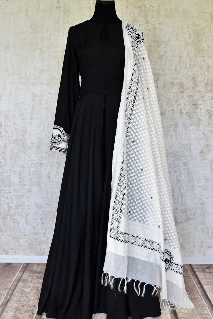 Buy black cotton silk embroidered Anarkali suit online in USA with white dupatta. Relive tradition in Indian designer lehengas from Pure Elegance Indian clothing store in USA. Enhance your ethnic look with Indian dresses, Anarkali suits and Indowestern dresses available online.-full view