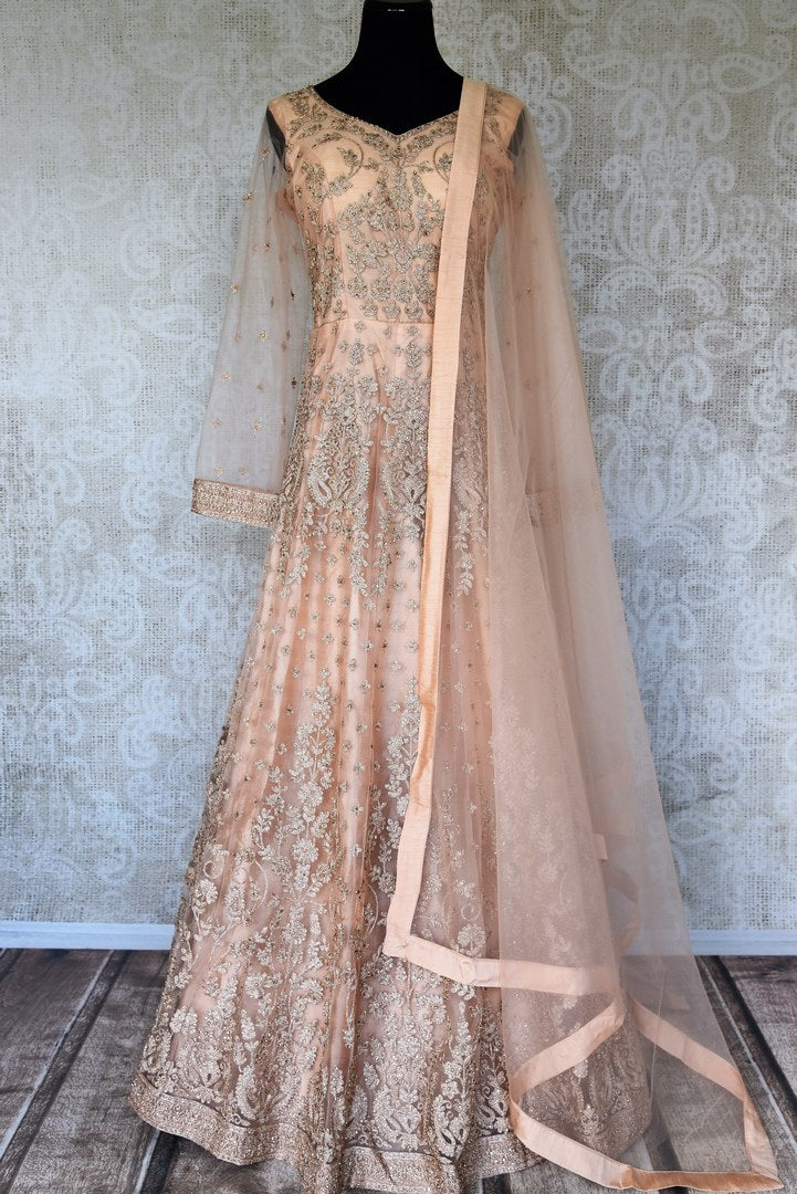 Buy peach embroidered net Anarkali suit online in USA with dupatta. Relive tradition in Indian designer suits from Pure Elegance Indian clothing store in USA. Enhance your ethnic look with Indian dresses, Anarkali suits and Indowestern dresses available online.-full view
