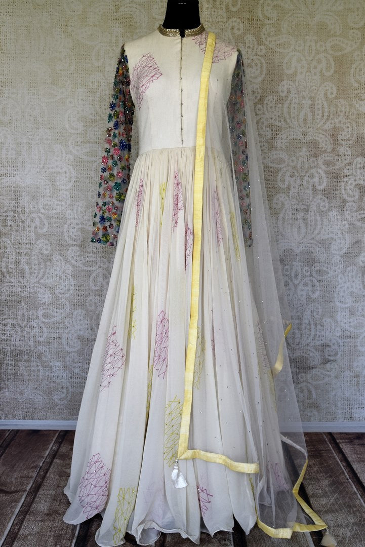 Buy white georgette Anarkali suit online in USA with net hand work sleeves. Radiate ethnic charm with beautiful Indian designer clothes from Pure Elegance Indian clothing store in USA. Choose from a variety of Anarkali suits, designer Indian suits, designer lehengas for special occasions.-full view