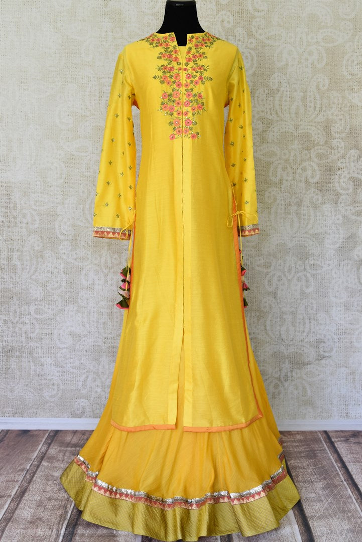 Buy yellow hand embroidered silk kurta with skirt online in USA. Channel your inner Indian diva with a range exquisite Indian designer dresses from Pure Elegance Indian fashion store in USA. Shop now.-full view