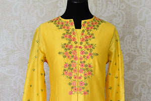 Buy yellow hand embroidered silk kurta with skirt online in USA. Channel your inner Indian diva with a range exquisite Indian designer dresses from Pure Elegance Indian fashion store in USA. Shop now.-front