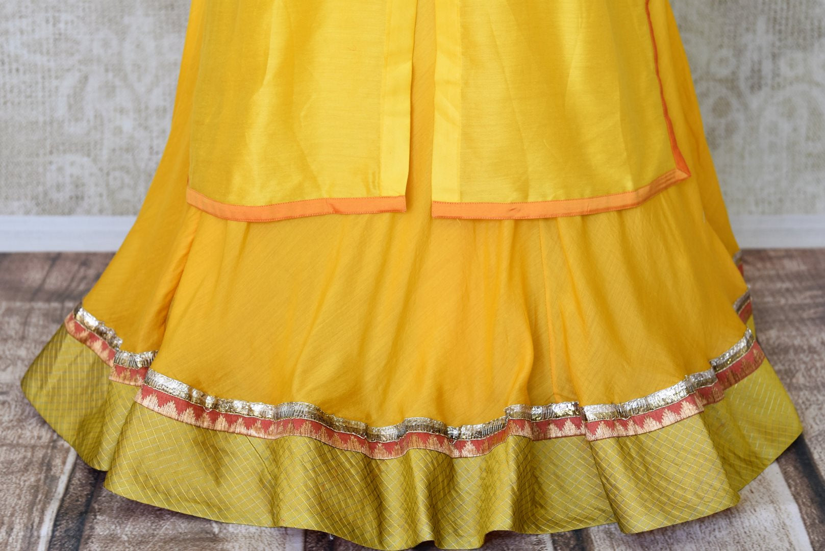 Buy yellow hand embroidered silk kurta with skirt online in USA. Channel your inner Indian diva with a range exquisite Indian designer dresses from Pure Elegance Indian fashion store in USA. Shop now.-bottom