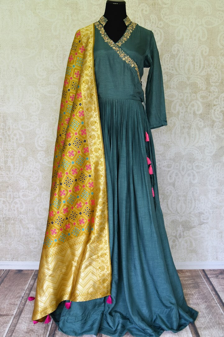 Buy teal embroidered silk Anarkali  online in USA with yellow dupatta. Elevate your traditional glam on weddings and special occasions with an exclusive range designer Anarkali suits especially for Indian women in USA at Pure Elegance Indian fashion store. -full view