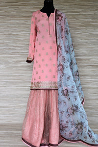 Buy soft pink embroidered georgette sharara suit online in USA with blue floral dupatta. Get your hands on exquisite Indian designer suits, wedding dresses in USA from Pure Elegance Indian clothing store for various special occasions like weddings and parties. Shop online now.-full view