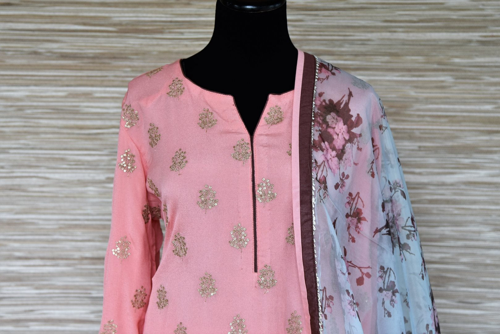 Buy soft pink embroidered georgette sharara suit online in USA with blue floral dupatta. Get your hands on exquisite Indian designer suits, wedding dresses in USA from Pure Elegance Indian clothing store for various special occasions like weddings and parties. Shop online now.-top
