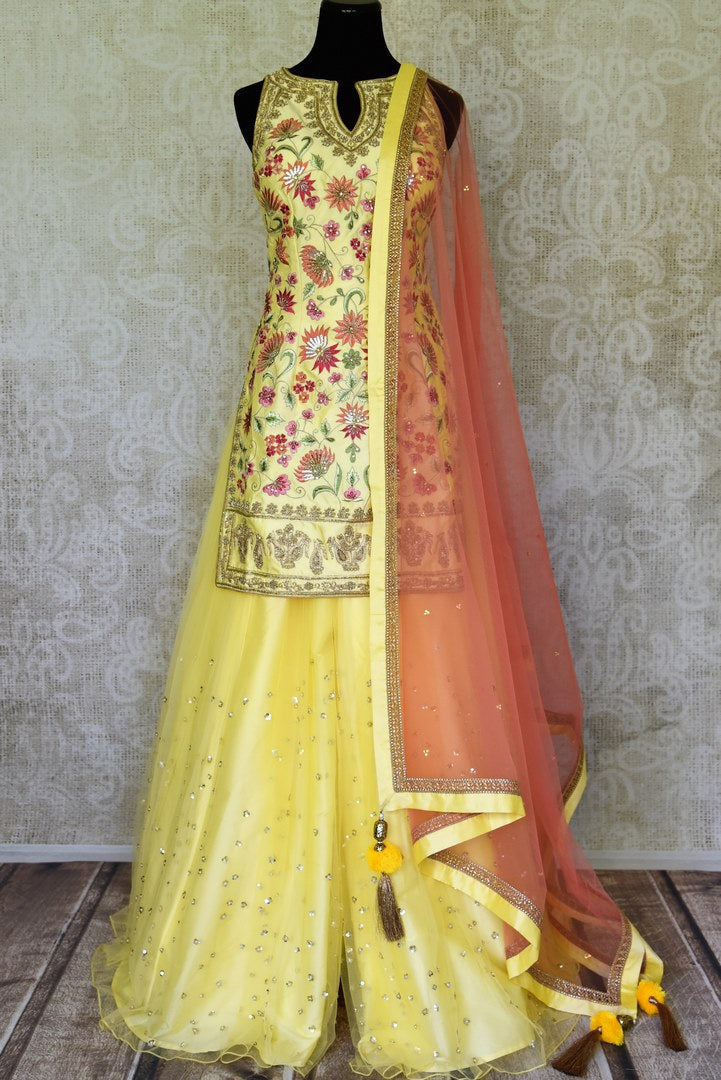 Shop gorgeous yellow embroidered net and silk sharara suit online in USA with pink dupatta. Step up your ethnic fashion game with exquisite variety of designer suits from Pure Elegance Indian clothing store in USA. Shop online.-full view