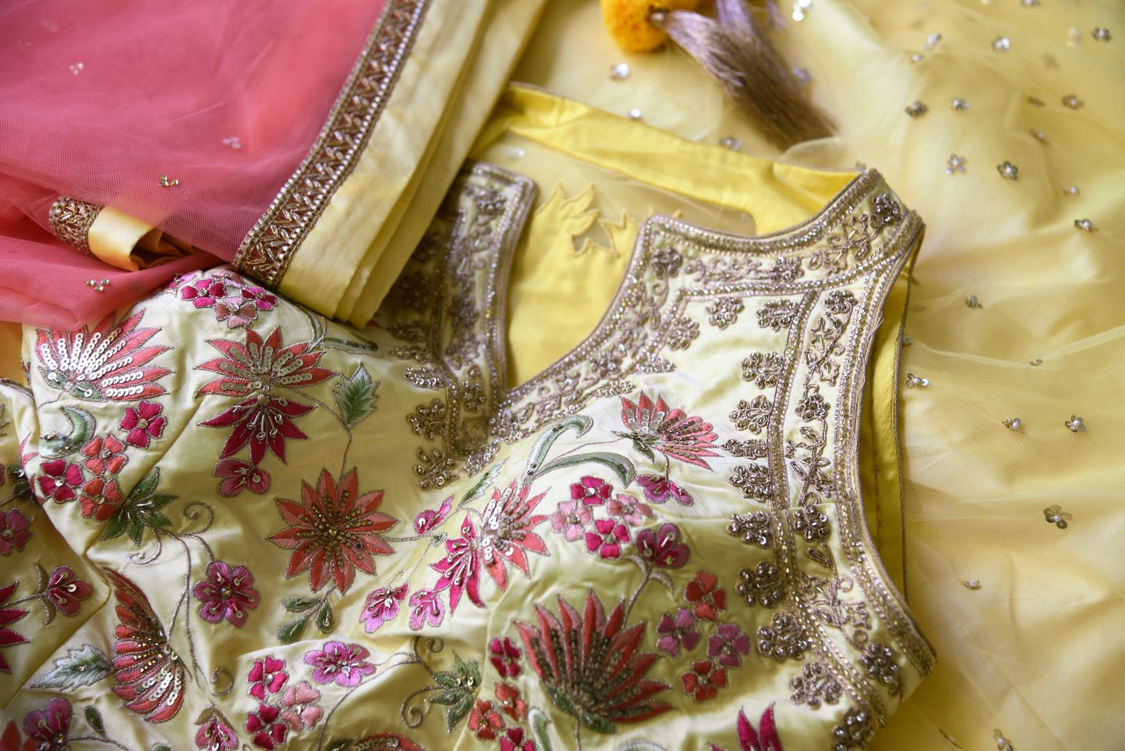 Shop gorgeous yellow embroidered net and silk sharara suit online in USA with pink dupatta. Step up your ethnic fashion game with exquisite variety of designer suits from Pure Elegance Indian clothing store in USA. Shop online.-details