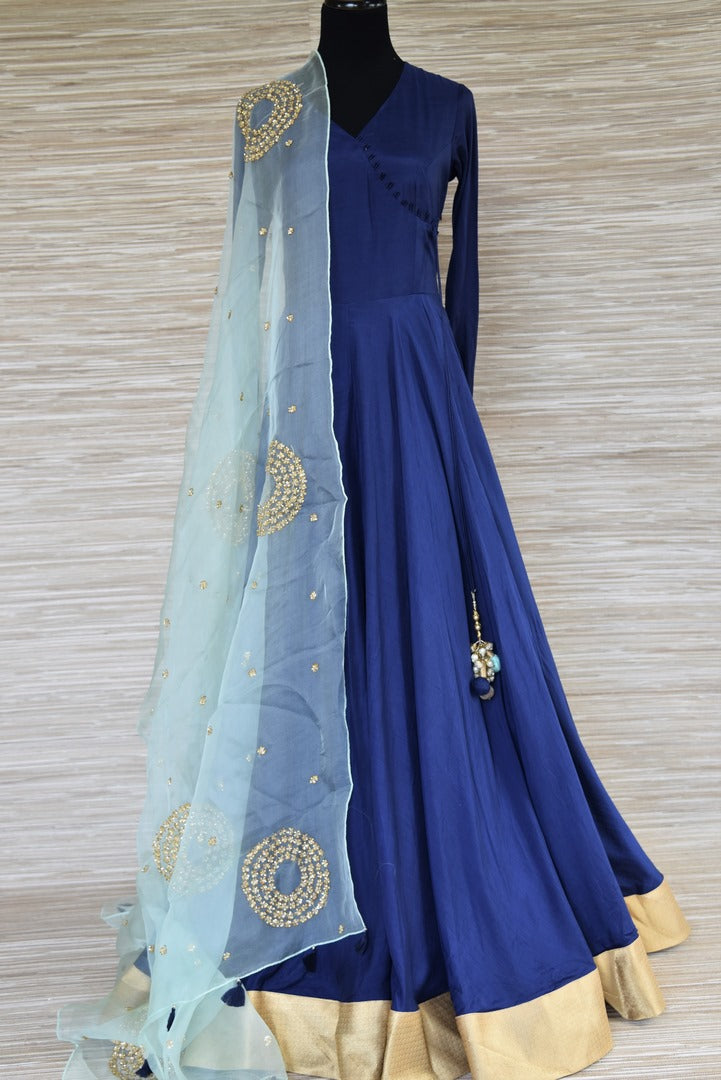 Buy beautiful dark blue chanderi silk floorlength Anarkali suit online in USA with light blue embroidered dupatta. Get your hands on exquisite Indian designer Anarkali suits in USA from Pure Elegance Indian clothing store for various special occasions like weddings and parties. Shop online now.-full view