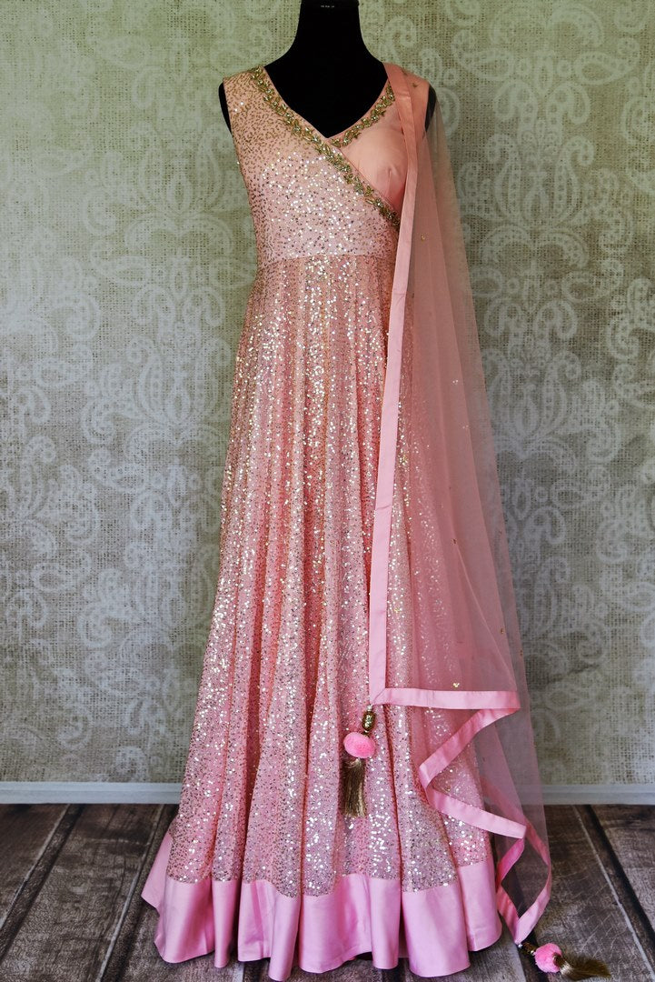 Shop baby pink sequin work georgette Anarkali online in USA with dupatta. Shine bright on weddings and special occasions with beautiful Indian designer suits, Anarkali suits, designer lehengas from Pure Elegance Indian fashion store in USA.-full view
