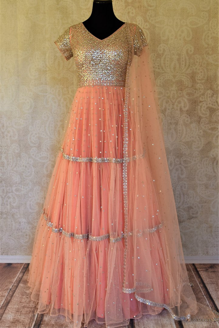Buy stunning dark peach embroidered gota patti net Anarkali suit online in USA with dupatta. Enhance your traditional style at weddings and festive occasions with designer Anarkali suits from Pure Elegance Indian clothing store in USA.-full view