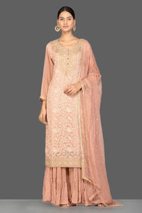 Buy beautiful dusty pink embroidered georgette sharara suit online in USA with dupatta. Be an epitome of Indian fashion with a premium range of designer suits, Anarkali dresses from Pure Elegance luxury Indian fashion store in USA. Buy online now.-full view